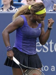 Serena Williams clenches her fist after breaking Ana Ivanovic, from Serbia, in the second set of a final match at the Western & Southern Open tennis tournament, Sunday, Aug. 17, 2014, in Mason, Ohio. Williams won 6-4, 6-1. (AP Photo/Al Behrman)