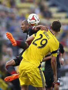 Toronto FC defender Justin Morrow, rear, falls to the ground after going for a header against Columbus Crew forward Adam Bedell (29) in the first half of an MLS soccer game Saturday, Aug. 9, 2014, in Columbus, Ohio (AP Photo/The Columbus Dispatch, Eamon Queeney)