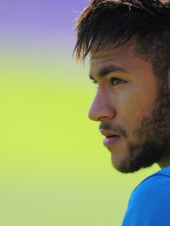 FC Barcelona's Neymar, from Brazil pauses, during a training session,  in San Joan Despi, Spain, Friday, May 16, 2014. Barcelona faces Spanish leader Atletico Madrid in a winner-takes-all league finale on Saturday, when the defending champion could yet lift its fifth title in six seasons.