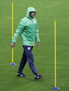 Algeria's coach Vahid Halilhodzic walks during a training session at the Arena do Gremio in Porto Alegre, Brazil, Sunday, June 29, 2014. Algeria will play against Germany on Monday in the round of 16 of the soccer World Cup. (AP Photo/Thanassis Stavrakis)