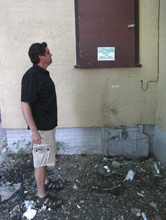 JOE BRYKSA / WINNIPEG FREE PRESS Landlord Steve Tait views a warning a new tenant posted on the rear window of her room that police will be called if customers of a drug dealer who used to live there drop around. It was formerly  a drive-thru window for the dealer's clientele.