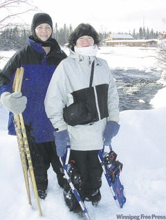 Lodge owner Daryl Oberg with daughter Joanna at the rapids, with Agamic Lodge behind them.