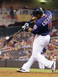 Minnesota Twins' Eduardo Escobar hits a single off Detroit Tigers pitcher Joba Chamberlain in the seventh inning of a baseball game, Friday, Aug. 22, 2014, in Minneapolis. Escobar went 5-for-6 at the plate, including a two-run home run in the second. The Twins won 20-6. (AP Photo/Jim Mone)
