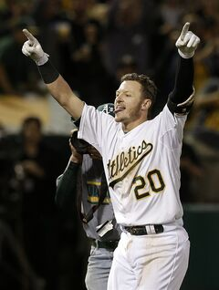 Oakland Athletics' Josh Donaldson (20) celebrates after hitting a three-run home run off of Detroit Tigers pitcher Joe Nathan during the ninth inning of a baseball game in Oakland, Calif., Wednesday, May 28, 2014. The Athletics won 3-1. (AP Photo/Jeff Chiu)