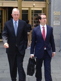 Defendant Paul Konigsberg, left, and attorney Reed Brodsky leave federal court in New York on Tuesday, June 24, 2014 after he pled guilty to conspiracy and two counts of falsifying books and records in a co-operation deal with the government. The 78-year-old Konigsberg, an accounting firm executive who worked for Bernard Madoff, told the court he was not aware of Madoff's