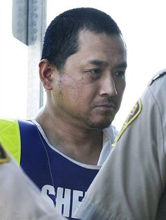 Vince Li is shown in a Portage La Prairie, Man., court Tuesday, August 5, 2008. The Canadian government and the RCMP have been quietly dropped from lawsuits filed after the beheading of a young man aboard a Greyhound bus in Manitoba.Victim Tim McLean's father filed a claim soon after his son was killed in the summer of 2008 against Greyhound, perpetrator Vince Li and Canada. THE CANADIAN PRESS/John Woods