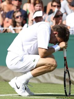 Nicolas Mahut takes a break at Wimbledon on Wednesday during  the longest match in tennis history.