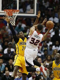 Atlanta Hawks forward Mike Scott (32) drives against Indiana Pacers center Ian Mahinmi (28) in the first half of Game 4 of an NBA basketball first-round playoff series, Saturday, April 26, 2014, in Atlanta. (AP Photo/John Bazemore)