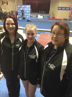 Left to right: Norman  gymnastics coach Casey Ranks, gymnast Eve Cooper and Flin Flon coach Sheena Reed.