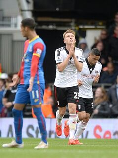 Fulham's Cauley Woodrow, center, celebrates scoring their first goal of the game during their English Premier League soccer match at Craven Cottage, London, Sunday, May 11, 2014. (AP Photo/Anthony Devlin, PA wire) UNITED KINGDOM OUT - NO SALES - NO ARCHIVES