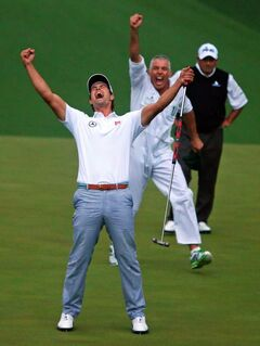 Adam Scott and his caddie Steve Williams show their jubilation as Scott's putt drops into the cup on the second playoff hole Sunday for his Masters victory. Runner-up Angel Cabrera watches in the background.