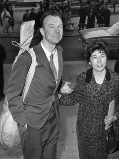 FILE - In this April 4, 1961 file photo, Pete Seeger, with a banjo slung over his shoulder, is accompanied by his wife, Toshi, as he arrives at the federal court in New York for sentencing on a conviction for contempt of Congress. The town of Beacon, N.Y. plans to honor the couple by renaming a riverside park in their honor, which is seen as a fitting tribute since they were instrumental in converting the former dump into Riverfront Park. (AP Photo)
