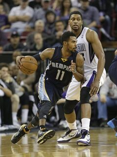 Memphis Grizzlies guard Mike Conley, left, drives against Sacramento Kings forward Rudy Gay during the third quarter of an NBA basketball game in Sacramento, Calif., Wednesday, Jan. 29, 2014. The Grizzlies won 99-89.(AP Photo/Rich Pedroncelli)
