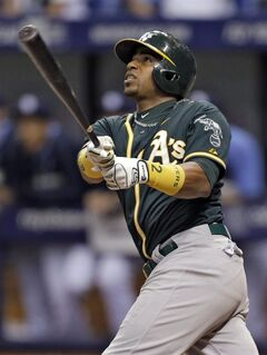 Oakland Athletics' Yoenis Cespedes follows the flight of his RBI sacrifice fly off Tampa Bay Rays relief pitcher Josh Lueke during the 11th inning of a baseball game Thursday, May 22, 2014, in St. Petersburg, Fla. Oakland's Josh Donaldson scored on the play. The Rays won 5-2. (AP Photo/Chris O'Meara)