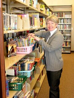 Head librarian Joan Spice shelves books at the Headingley Municipal Library, located at 49 Alboro St.