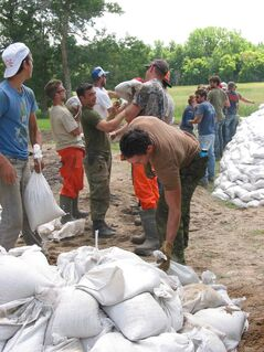 Volunteers sandbagged on July 8 to protect Keven and Gloria Van Camp's  home in the RM of St. Francois Xavier.