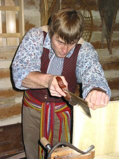 In this file photo from this year's Festival du Voyageur, volunteer Travis Lavallee works on a blanket chest in a workshop at Voyageur Park.