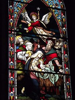 This is one of the first two windows placed in the old church in 1887 — The Nativity by J. Wippell of England, C. 1886.