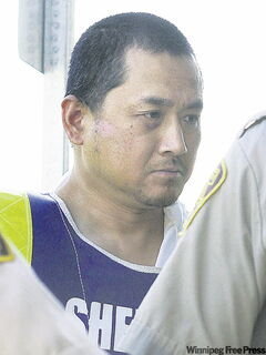 FILE--Vince Li, the accused in the Greyhound bus beheading of Tim McLean,  appears in a Portage La Prairie court Tuesday, August 5, 2008 and was ordered by the judge to undergo a psychiatric assessment.The public may never know whether a man who decapitated a fellow passenger on a Greyhound bus will be institutionalized or given a conditional release. A criminal review board determining Vince Li