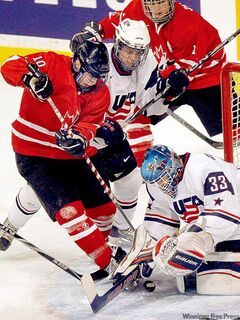 Ontario's Brendan Gaunce digs at a puck in front of the Team USA net.