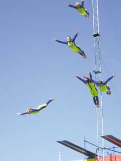 Members of the Flying Fools High Dive Show will execute airborne manoeuvres for Red River Ex crowds.