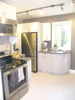 The kitchen after the renovation (above) and during the renovation (below). Lianne wanted to increase the kitchen's counter space. This was accomplished by tearing out the circa-1945 cabinets and replacing them with custom-built units by Mosaic Millwork of Winnipeg. The painted wood cabinets not only increased the kitchen's countertop space about 10-fold, but added much-needed storage space, as did a new pantry.