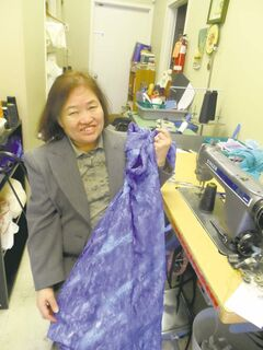 Tailoring mama Jung Kim doesn�t need a pattern to create dresses at Hannah�s Dressmaker.