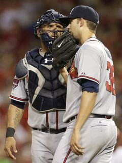 Atlanta Braves starting pitcher Mike Minor (36) talks with catcher Gerald Laird in the fifth inning of a baseball game against the Cincinnati Reds, Friday, Aug. 22, 2014, in Cincinnati. (AP Photo/Al Behrman)