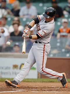 San Francisco Giants' Joe Panik hits an RBI-single against the Chicago Cubs during the sixth inning of the�continuation�of a�baseball�game that began�Tuesday, on Thursday, Aug. 21, 2014, in Chicago. Tuesday's�game was suspended in the fifth inning due to rain. (AP Photo/Andrew A. Nelles)