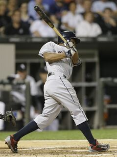 Cleveland Indians' Michael Bourn (24) hits an one-run single against the Chicago White Sox during the third inning of a baseball game in Chicago, Wednesday, Aug. 27, 2014. (AP Photo/Nam Y. Huh)