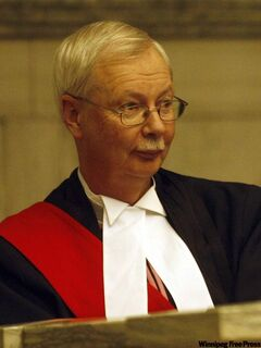 A Nov. 2009 file photo of Manitoba Judge Robert Dewar, who recently spared a convicted rapist jail time because the victim sent signals that