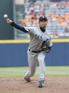 Seattle Mariners starting pitcher Hisashi Iwakuma works in the first inning of a baseball game against the Atlanta Braves Wednesday, June 4, 2014 in Atlanta. (AP Photo/John Bazemore)
