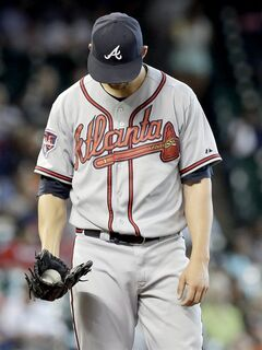 Atlanta Braves starting pitcher Mike Minor hangs his head after giving up a three-run homer to Houston Astros' Matt Dominguez in the fifth inning of a baseball game Thursday, June 26, 2014, in Houston. (AP Photo/Pat Sullivan)