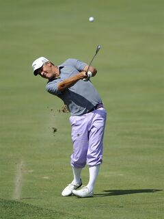 Fredrik Jacobson, of Sweden, hits from the 14th fairway during the third round of the Quicken Loans National golf tournament, Saturday, June 28, 2014, in Bethesda, Md. (AP Photo/Nick Wass)