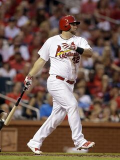 St. Louis Cardinals' Matt Adams watches his ground-rule double that scored Matt Carpenter during the third inning of a baseball game against the New York Yankees on Tuesday, May 27, 2014, in St. Louis. (AP Photo/Jeff Roberson)