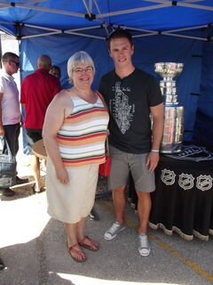 MLA Christine Melnick and hockey superstar Jonathan Toews with the Stanley Cup at the Jonathan Toews Community Centre on July 19, 2013.