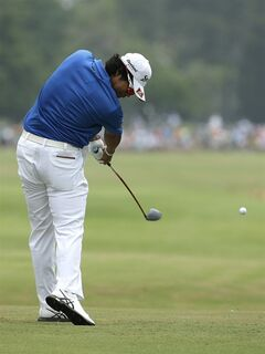 Hideki Matsuyama, of Japan, hits his tee shot on the 12th hole during the first round of the U.S. Open golf tournament in Pinehurst, N.C., Thursday, June 12, 2014. (AP Photo/Charlie Riedel)
