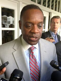 FILE - In a May 30, 2014 file photo, Detroit emergency manager Kevyn Orr speaks with reporters after addressing the Mackinac Policy Conference on Mackinac Island, Mich. In the little more than a year since Orr made Detroit the largest U.S. city to seek bankruptcy protection, it has experienced a wide range of improvements that will factor into Judge Steven Rhodes' decisions during next month's bankruptcy trial. A major piece of the bankruptcy puzzle could fall into place Monday, July 21, 2014, with the expected release of the results of a vote by creditors, including more than 30,000 retired and current city workers, on whether to accept millions of dollars in cuts. (AP Photo/David Eggert, File)