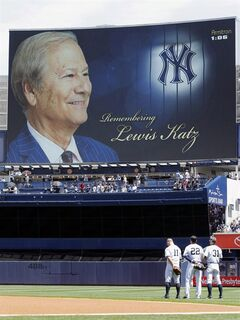 In this photo provided by the New York Yankees, players and fans observe a moment of silence, Sunday, June 1, 2014, before a baseball game in New York, between the Minnesota Twins and New York Yankees, for Lewis Katz, a minority owner of the Yankees who died Saturday night in a plane crash.�(AP Photo/Courtesy New York Yankees)