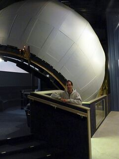 In this Oct. 23, 2011 photo, Frank Kovac Jr. stands outside the Kovac Planetarium in Rhinelander, Wisc. Kovac built the planetarium over a 10-year period, from 1997 to 2007, and named it in memory of his father who died in 1997. (AP Photo/Roger Schneider)