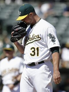 Oakland Athletics pitcher Jon Lester stands on the mound after allowing a single to Seattle Mariners' Mike Zunino during the seventh inning of a baseball game in Oakland, Calif., Wednesday, Sept. 3, 2014. The Mariners won 2-1. (AP Photo/Jeff Chiu)
