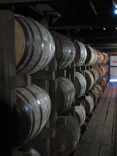 In a July 24, 2014 photo, bourbon supplies age in barrels at the Jim Beam distillery in Clermont, Ky. Kentucky bourbon makers have stashed away their largest stockpiles in more than a generation due to resurgent demand for the venerable brown spirit. (AP Photo/Bruce Schreiner)