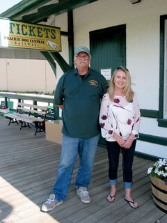 Bob Goch, president of the Vintage Locomotive Society Inc., and Catherine Duffin, Prairie Dog Central Railway's marketing manager, stand outside the train depot in the RM of Rosser.