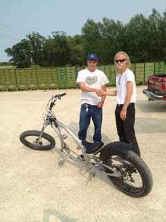 Steven Unruh, left, returned a custom-built bike to Keith Dyck on Thursday after it was stolen last week.