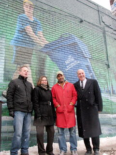 From l-r: Winnipeg artist Charlie Johnston, Multi-Material Stewardship Manitoba executive director Karen Melnychuk, Avenue Meats co-owner Wondimu Kidane and Take Pride Winnipeg! Inc. executive director Tom Ethans stand beneat Johnston's latest mural, which is painted on the side of the Selkirk. Ave. grocer.