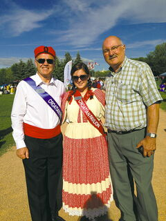Miro Gospic (left), Croatioan pavilion ambassador and Joso Zizic, pavilion co-ordinator (far right) pose with another pavilion ambassador at the official Folklorama kickoff at The Forks on July 27.