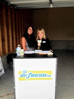 Fresh FM morning show host Jennifer David and StreetSide sales and marketing manager Jessica Willis celebrate at the StreetSide Royalwood block party.