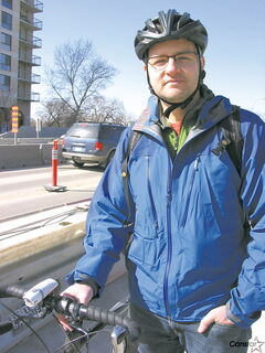 Bike to the Future's Gareth Simons, pictured on the east side of Osborne Bridge that will soon be under construction, has some concerns about cyclist safety.