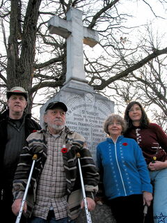 From left: Art Bloomfield, Larry Haag, Karen Moffatt and Carolyn McIntyre seen next to a restored cenotaph in St. Norbert Cemetery.