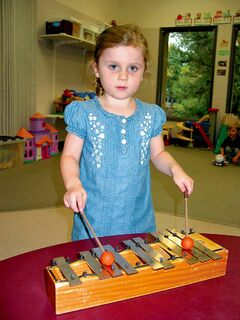 Four-year-old Audrey practices her xylophone skills at Windsor C.C.
